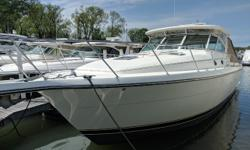 The Tiara 40 is a luxury-class Express Yacht with 2 staterooms and 2 heads plus a large galley, oversize dinette and teak & holly floors throughout. The forward stateroom has a walk-around queen bed with a head with private entrance. The aft stateroom has