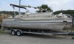 1999 Voyager Express Fish & Cruise 25' Pontoon, 2013 Mercury 150 HP Optimax only 125 Hrs., Stainless Propeller, Fish Finder, Depth Finder, 55lb Thrust Trolling Motor, Large Bimini Top, 6 Fishing Chairs, Ski Tow, Under Deck Pull Out Ladder, Docking Lights,