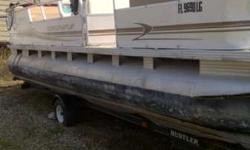 Quiet Efficient Family Pontoon Powered by a 2003 Suzuki 70 hp Four Stroke. The motor is scheduled to have its carburetor cleaned and a waterpump impeller installed. Seats are good enough to use but we have an upholstery man on sight. See the other 2000