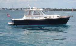 AccommodationsThe Southern Star is well equipped below with a fully-functional galley on the port side and a large U-shaped dinette to starboard. Just forward of the galley on the port side is the head and shower with Vacuflush head. All the way forward