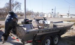 2000 AAD Custom Plate boat on a Heavy duty homemade trailer with a 2002 140hp Suzuki Four-Stoke. The boat has a console, under bow storage and a rear storage box. The trailer has tandem axles. The engine has a ss prop. Beam: 7 ft. 2 in.
