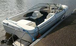 THIS SUPER WIDE AND SPACIOUS 21' BOWRIDER SPORTS THE 5 LITRE V8 MERCRUISER STERNDRIVE, ALL COVERS INCLUDED, GOOD TRAILER , FLOOR SKI STORAGE, SWIM LADDER, SKI TOW RING, NICE INTERIOR AND EXTERIOR, OUR WARRANTY COMES WITH IT, WE WATER TEST THE UNIT TO FINE