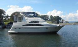 2000 Carver 396 Motor Yacht This is a very clean Fresh Water Undercover 396 Motor Yacht that has only 875 hours on twin Mercruiser 454 Horizon Inboards. It is equipped with 2 Full Staterooms with Island Beds and two Heads and Showers. It has about 1250