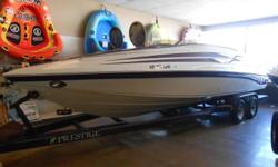 2000 Crownline 266 LTD cuddy cabin equipped with Mercruiser 454 Mag with Bravo III drive. Boat includes bimini top, snap cover, docking lights, extended swim platform, table, rear ladder, auto fire ext. Captain's call (exhaust S.C.), depth finder, radio