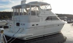 Knee Deep is a very contemporary aft cabin cruiser with rakish lines and a surprisingly spacious interior. She has the accommodations of a 40 footer with her queen beds in both staterooms, a full dinette and galley and a tub in her aft head compartment.