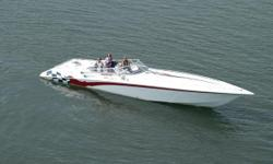 This 42 Lightning is powered with a pair of Staggered 1100hp Supercharged engines, with #6 Speedmaster drives. There are less than 50 hours on these fresh engines, and less than 400 hours total on this single owner, 100% freshwater boat. All of the