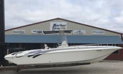 *** Stock Number ** 2000 Fountain 29 Center console twin 2000 Mercury 225HP 2 stroke fuel injected oil injected ** Canvas T-Top w/Electronics box ** VHF Radio ** Compass ** Simrad FF/GPS ** Sony Marine Stereo ** SeaStar Hydraulic Steering - Dual ** Trim