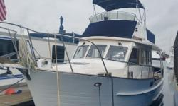 This is one sweet little trawler here. She's a 2000 32' Island Gypsy Europa that is in great shape and currently on the hard for your easy inspection. Please call for the long list of accessories and upgrades included,-------but better yet, call today to