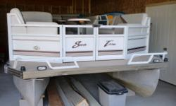 This boat has been stored inside during the winter. The 75hp Mercury 4 stroke will provide plenty of power for cruising with a boat full of your friends. There is a mooring cover and a bimini top. Beam: 8 ft. 6 in. Hull color: Taupe/white Boat cover;