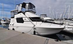 """Space, space and more space is what you'll find with this incredible layout. Full beam salon with convertible settee. Silverton's signature """"Sidewalk design"""" to foredeck. Two comfortable staterooms and two electric heads. Separate stall shower in the"""