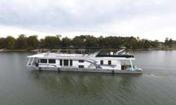 2000 Stardust 92' X 19.5' Houseboat This is a highly customized Wide Beam Houseboat that has been kept in a covered slip for the last 10 years. It is powered by twin Mercruiser 5.7l EFI Bravo II with only 230 hours. It has a Westerbeke 20KW Generator with
