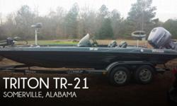 Actual Location: Somerville, AL - Stock #095393 - Freshwater Triton ready to go and loaded.The Triton TR 21 Bass is loaded and ready to go. It features a Johnson HO 2 stroke 225 Horse Power outboard, it's a carb engine. -Pro high jacker jack plate-Minn