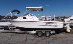 This is a very nice 230 Hydra Sports with a brand new trailer and hard top. She has a Garmin Chartplotter, porta head, live wells, fish boxes, and a bracketed motor. She is beamy and has a large cockpit to give you plenty of fishing room. She has low