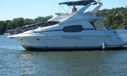 """Condo-style accommodations made this roomy sportcruiser popular with buyers. Distinctive """"Sidewalk"""" deck configuration with elevated side decks results in cavernous and innovative full beam salon with raised galley/dinette platform forward.BANK OWNED."""