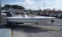 2001 Action Craft Flatsmaster 1890SE with a Yamaha HPDI 150 and a aluminum single axle trailer.  This boat comes with a Motor Guide trolling motor, Garmin GPS/Depthfinder, poling platform, hydraulic steering, trim tabs, bimini top, and a stainless