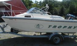USED LOCALLY ON OUR LAKE THIS FRESH WATER UNIT HAS THE 125 MERCURY OUTBORD, GALVANIZED TRAILER WITH NEW TIRES AND BEARINGS, NEW SPARE TIRE, LOWRANCE FISHFINDER W/GPS UNIT, NEVER SAW SALT WATER! SUNTOP WITH SIDE CURTAINS, GLAS LINER, WALKAROUND BOW, GREAT