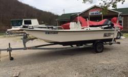 2001 Carolina Skiff w/ Yamaha 50hp 2stroke w/ Trim & Tilt 24V 55#Thrust Trolling Motor Bimini Top Trailer Guides Single Axle trailer  Nominal Length: 17' Length Overall: 17' Engine(s): Fuel Type: Other Engine Type: Outboard Beam: 6 ft. 4 in.