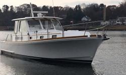 Motivated seller moving on to a larger boat.  Bring all offers! PRICED TO SELL.!! This Grand Banks 43 Eastbay Hardtop Express was yet another addition to the popular Eastbay series of classic Downeast cruisers first introduced by Grand Banks in