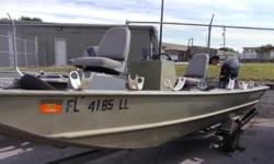 2001 1648MT Lowe Jon boat, with a Evinrude E-tec 30hp and galvanized trailer. Includes a center console, pedestal fishing seat, and trim and tilt.