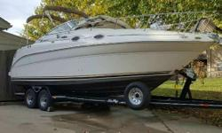 2001 Searay 260 Sundancer Cruiser with newer Mercruiser 5.7 V8 with Bravo 3 sterndrive. Boat has 630 hours with only 140 hours on the newer Mercruiser motor. White and tan sitting on a custom 2009 Heritage tandem axle trailer with disc brakes. This boat