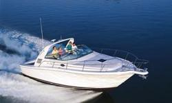 """The Sea Ray 340 Amberjack, perfect for fishing or cruising, features a wide beam and large cockpit. Several passengers can sit comfortably in the folding cockpit seating while cruising. """"Very Civilized"""" is the best term for this tough diesel fishing"""