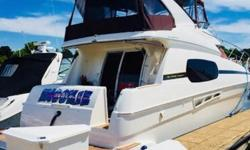 """Broker's notes: Please note-this boat is in a heated facility for the winter. Very easy to see, just need to make an appointment. Trades considered!  Wow! """"Snookie"""" is ready to rock! This beautiful 410 Silverton Sportbridge is a freshwater beauty!"""