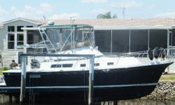 2002 Albin 35 Command Bridge. Beautiful example of the former 32+2 Albin classic cruiser. Lift kept. Dark green hull. Cat diesel 3126 with 1127 hours 350 HP. Onan 5 Kw generator with 375 hours. Inverter.  Reverse cycle central air conditioning