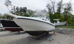 2002 Boston Whaler 295 Conquest REPOWERED IN 2009!! Powered by twin 2009 Suzuki 250 4-strokes. This boat is designed for both fishing and cruising. Accommodations include full V-berth with enclosed head and shower with galley. A large cockpit with 30
