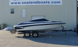 Nice pre-owned 2002 Crownline 202 Bowrider with a Volvo 5.7 GI 280 horsepower V8 motor with duoprop outdrive sitting on a custom Prestige tandem axle trailer with brakes. Sport interior with rear bench seat and large sundeck, driver and passenger flip up