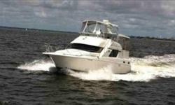 Beautiful 2002 Silverton 392 Motor Yacht - The best in it's class! Climb aboard this 392 from the stern and immediately feel her welcoming oversized aft-deck. This vessel is perfect for a live on or extended stay with all of the comforts of home The