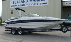 2003 Crownline 230 EX Deckboat with a Volvo 5.7 GXI Duoprop (320 horsepower) motor sitting on a custom color matched Prestige tandem axle trailer with brakes. Immaculate condition with less than 200 hours, this boat was sold new and always serviced here.