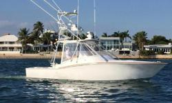 This fantastic express boat is the perfect platform for fishing and island trips. She offers a center island helm setup with bench seating to port and starboard. Large refrigerated drink boxes and plenty of storage ensure you have room for all