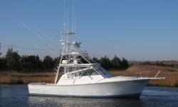 ENGINES HAVE BEEN REMOVED, REBUILT, PAINTED AND LOOKING BETTER THAN NEW! Don't miss a chance to own this custom Jersey built boat with Palm Beach style! Well maintained El Bravo with a beautiful ash interior, teak cockpit AND colored hull! Twin 500 hp