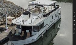 MONTICELLO RIVER YACHT - BRAND NEW LISTING! FRESHWATER - LOW HOURS - ONLY 275 ON ENGINES & 450 ON GEN 2003 Monticello River Yacht 70x16 - YOU CAN HAVE IT ALL!  Houseboat luxury with planing cruiser v-shaped hull w/ full keel, twin
