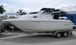 2003 Sailfish 234 WA with Yamaha 200 HPDI with only 300 hours on it. Whether you are overnight cruising or offshore fishing, this Walk Around is loaded with amenities needed to complete each of your trips. With a loaded down V-Berth, with table/ bed