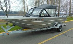 2003 Thunderjet Envoy This Thunderjet is Ready To Fish! Check out the Video! ? Humminbird 405 SX Fish/Depth Finder ? Uniden Oceanus VHF Radio ? Windshield Wiper Beam: 7 ft. 0 in. Stock number: 03TJ19