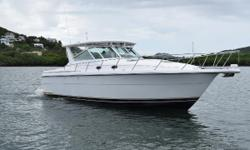 This is a One Owner two-stateroom midcabin with teak interior and teak & holly sole. It is fitted with a hardtop and custom refrigerator and helm seat. Super clean and lightly used. This is a very spacious Express style boat that feels much