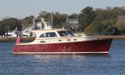 """This 2003 Vicem 42 Classic is easily a contender for """"prettiest girl at the dance"""". Her Khaya mahogany and epoxy composite construction make for an incredibly strong and light hull, and stepping aboard gives the firm feel that only solid teak and"""