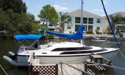 MINT condition MacGregor motorsailer/sailboat and trailer with surge breaks - the best of both worlds! Garman GPS map 188C color sounder/split screen with Bluechart Southwest Florida chip, easy trailering with mast-raising kit, rotating mast for improved