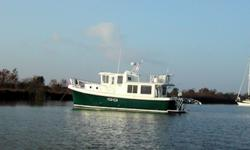 Description For full and complete specificationsplease click here. Motivated Seller! JUST WAXED APRIL 2011! Vessel Walkthrough She has a lovely cruising interior for a couple. The master stateroom is forward with a centerline double berth storage