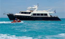 Vessel WalkthroughAfter crossing the teak planked aft deck which has ample seating a wet bar and full walk-around side decks you enter the main salon through an oversized door. With teak and holly soles and satin finished cherry wood the salon is warm and