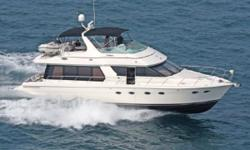 """The 57' Voyager is Carver's Flagship Yacht. At 59'2"""" with a stable beam of 15'4"""", this beauty handles the seas, as well as entertaining friends and family. This particular Voyager boasts fresh water pampering, and is ready for a new owner. 2 Surround"""