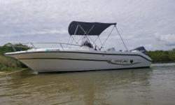 This second owner 20' Center Console has always been covered and has gel coat shine like new, stored indoors for 8 years. Yamaha 150HP fuel injected outboard has very low hours and just had it's 100 hour service done 6/2018. Dual batteries. Live