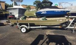 Just reduced $500. This boat is equipped with a Mercury 9.9 fours troke, Ez loader galvanized trailer, 3 spare tires, minnkota 40# transom mount troller, custom cover, 2 bass seats and oars. Nominal Length: 14' Length Overall: 14' Engine(s): Fuel Type: