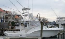 The OUT ISLAND 38 2004 EXPRESS FISHERMAN is simply in a class by itself. From the Carolina flare to classic tumblehome and rounded transom, her lines scream custom. In an age where most boats appear cookie cutter and very similar, the OUT ISLAND is sure