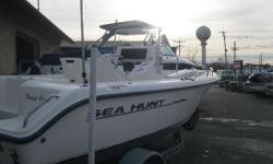 NEW INVENTORY 2004 Sea Hunt Triton 18CC This Sea Hunt 19ft CC is in good shape & is a nice, boat, motor, & trailer package that is ready for the water! This boat comes w: Johnson 115 hp 2 stroke Wesco Bunk Trailer Bimini Top Dual Capt Chairs VHF Radio