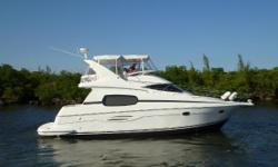 This SUPER CLEAN 2004 Silverton 410 sport bridge packs good old middle America living space, and plenty of it inside her racy exterior. The salon opens up like a 45 footer thanks to unique forward sidewalks to the bow and the natural light pouring through