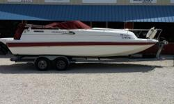 This Splendor 240 Platnium has come out of our hanger where she has been stored for quite a while. It shows like new with no dash fade or vinyl fatigue. She is equiped with a GPS, Camper Bimini, Mooring Cover, carpeting, New Batteries and a Porta-Potty.