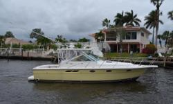 This 2004 Tiara 3100 Open has been kept on a lift. Her gracious cockpit gives plenty of room for fishing,diving, or pleasure crusing around the intercostal. Powered by twin Cummins 330hp she will cruise efficiently in the mid 20s (30+ knots wide open).