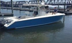 Mint condition absolutely loaded 2004 34 Venture Cuddy. Venture build the finest in offshore center consoles and this is a rare chance to own there overnighter version the 34 Cuddy. Enormous 585 quart macerated fishbox, huge 55 gallon livewell, along with